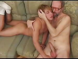 Old and young gay lovers have sex on the couch